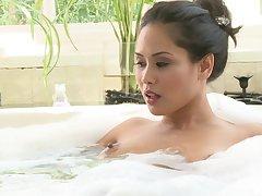 Asian pornstar Jessica Bangkok gives a blowjob and earns cum aloft tits