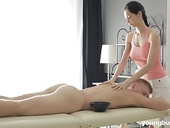 Slender masseuse with big tits Emma L gets intimate with one of her custom