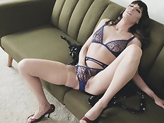 Energized wife sits on her couch and masturbates in passionate XXX