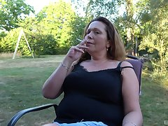 Smoking adult lady finger fucks their way cunt in the backyard