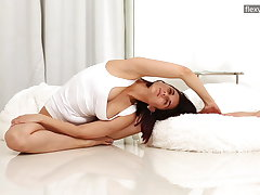 Busty brunette Alica Bruno is super flexible