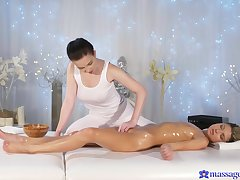 Crazy personify aloft the massage table between duo sensual lesbians
