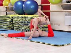 Lovely teen almost flexible body Dora Tornaszkova shows yummy pussy